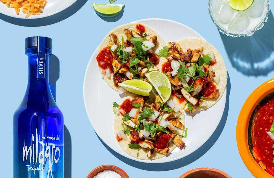"""<p>Boozy tacos anyone? In this recipe from Esteban Castillo, author of <a href=""""https://www.amazon.com/Chicano-Eats-Recipes-Esteban-Castillo/dp/0062917374//ref=as_li_tl?ie=UTF8&amp%3Bcamp=1789&amp%3Bcreative=9325&amp%3BcreativeASIN=62917374&amp%3BlinkCode=as2&amp%3Btag=thedailymeal-editorial-referral-20&referrer=yahoo&category=beauty_food&include_utm=1&utm_medium=referral&utm_source=yahoo&utm_campaign=feed"""" rel=""""nofollow noopener"""" target=""""_blank"""" data-ylk=""""slk:Chicano Eats"""" class=""""link rapid-noclick-resp"""">Chicano Eats</a>, chicken is marinated in a blend of tequila, orange juice, serrano peppers, cilantro and more. The tangy combo has a dynamic blend of flavors that are brought to life when then chicken is tossed onto the grill. </p> <p><a href=""""https://www.thedailymeal.com/recipes/grilled-citrus-tequila-chicken-tacos?referrer=yahoo&category=beauty_food&include_utm=1&utm_medium=referral&utm_source=yahoo&utm_campaign=feed"""" rel=""""nofollow noopener"""" target=""""_blank"""" data-ylk=""""slk:For the Grilled Citrus Tequila Chicken Tacos recipe, click here."""" class=""""link rapid-noclick-resp"""">For the Grilled Citrus Tequila Chicken Tacos recipe, click here. </a></p>"""
