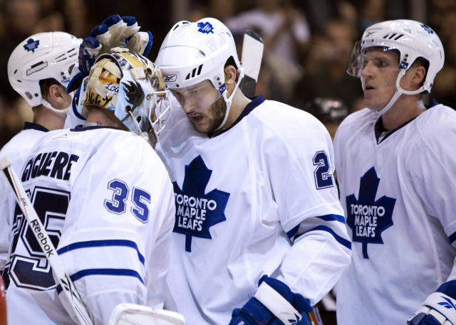 "FILE - In this Feb. 2, 2010, file photo, Toronto Maple Leafs goaltender Jean-Sebastien Giguere, left, is congratulated by teammates Christian Hanson, center, and defenseman Dion Phaneuf, right, after a 3-0 shutout win over the New Jersey Devils in an NHL hockey game in Toronto. The 1977 movie ""Slap Shot"" was No. 5 in The Associated Press' Top 25 favorite sports movies poll. ""Anybody who's played the game can still relate to it in some capacity because as much as it's changed, a lot of it is still the same,"" said Christian Hanson, the son of Dave Hanson, who played one of the Hanson brothers in the film, and himself a veteran of 42 NHL games with Toronto between 2008-2011. (Frank Gunn/The Canadian Press via AP, File)"