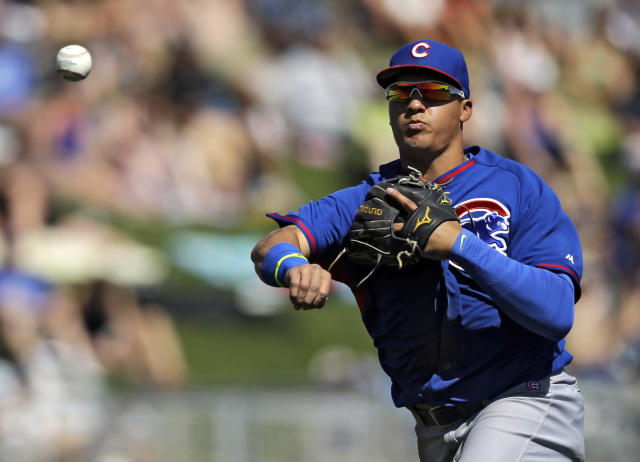 Chicago Cubs shortstop Javier Baez throws out Chicago White Sox's Marcus Semien at first in the fourth inning of a spring exhibition baseball game Friday, March 21, 2014, in Glendale, Ariz. (AP Photo/Mark Duncan)