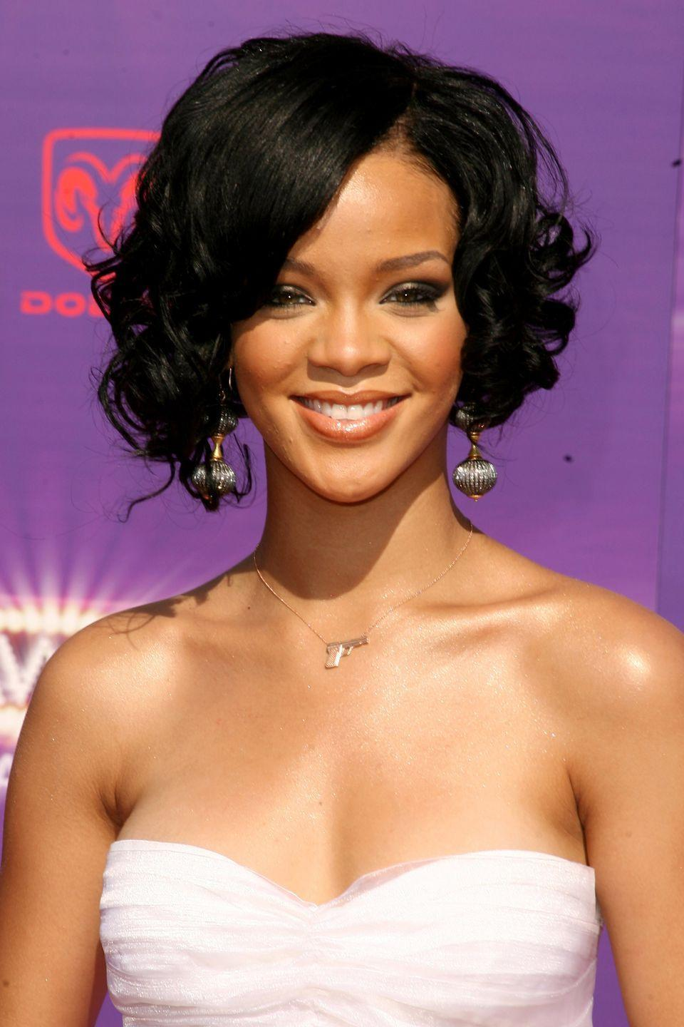 <p>Rihanna switches it up and wears her bob with curls. </p>
