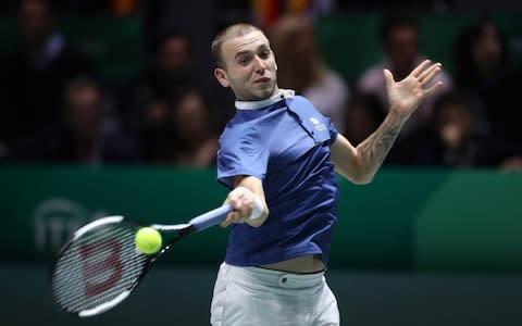 <span>Dan Evans had earlier suffered a second rubber loss to Rafa Nadal </span> <span>Credit: Getty Images </span>