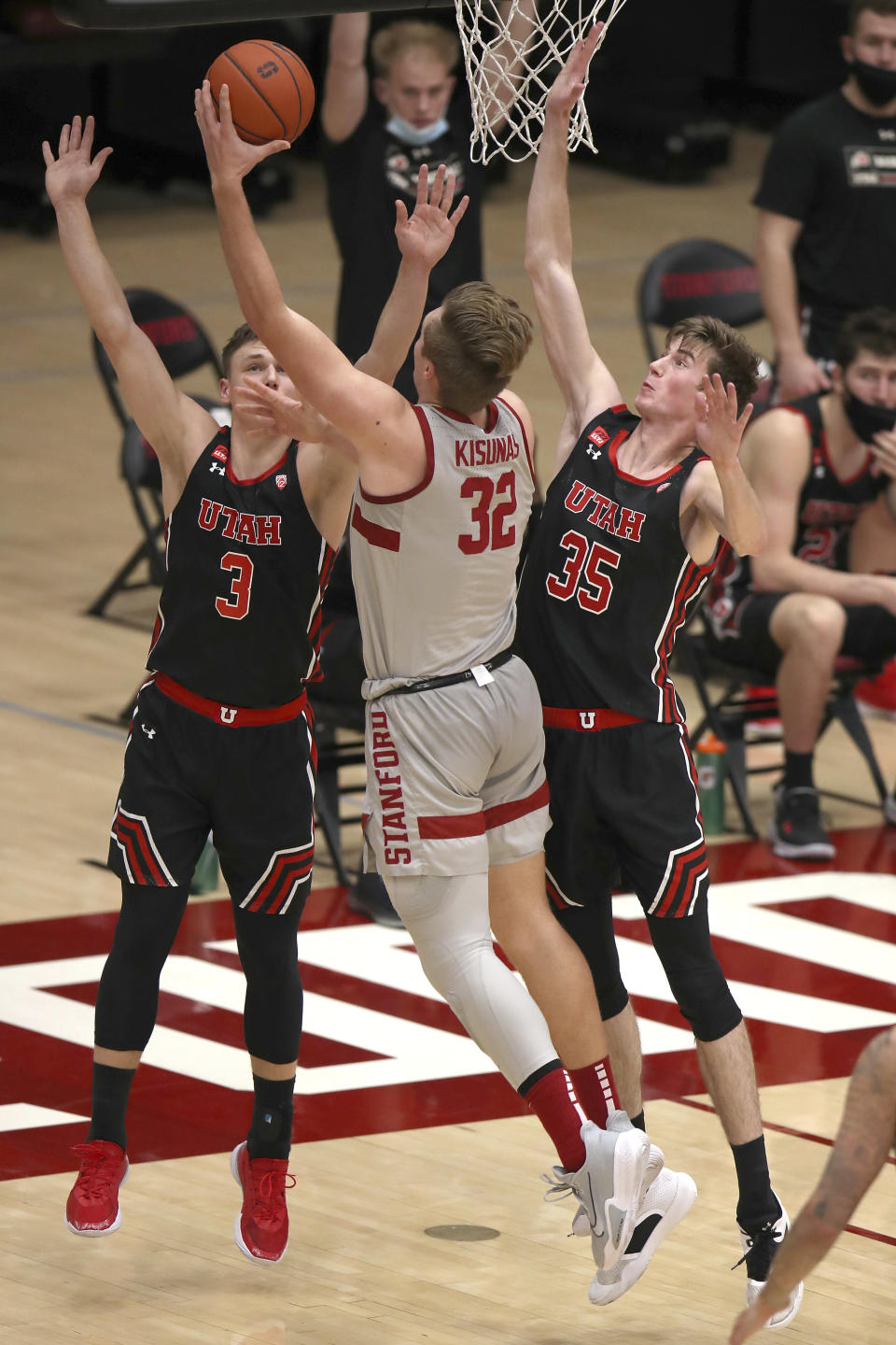 Utah guard Pelle Larsson (3) and center Branden Carlson (35) defend against Stanford forward Lukas Kisunas (32) during the first half of an NCAA college basketball game Saturday, Feb. 13, 2021, in Stanford, Calif. (AP Photo/Scot Tucker)