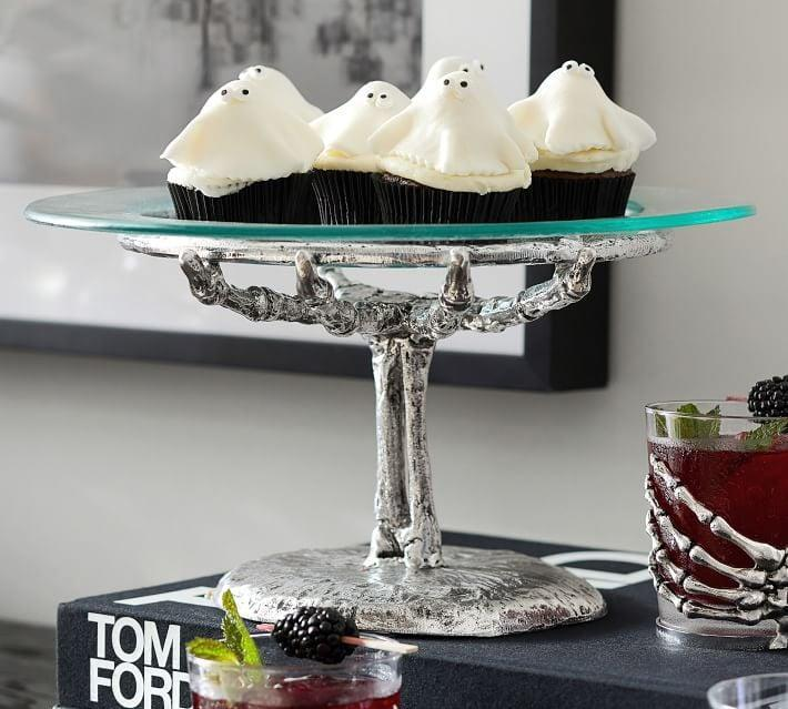 <p>If you're a baker, this <span>Skeleton Hand Cake Stand</span> ($90) is a spooktacular idea. </p>