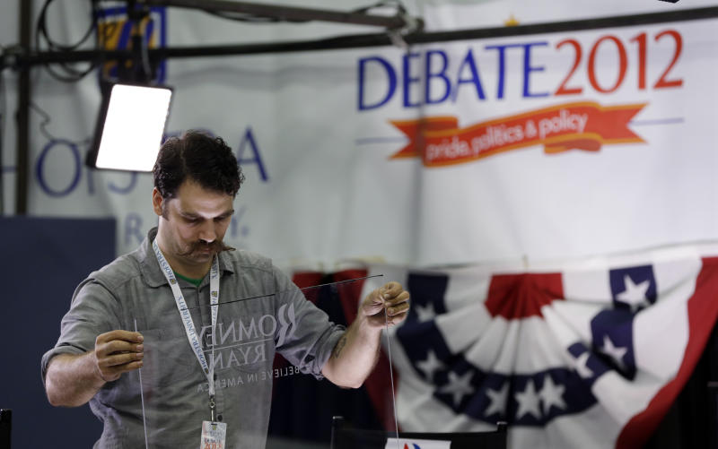 A worker prepares a set in the media filing center in preparation for the Presidential debate at Hofstra University, Monday, Oct. 15, 2012, in Hempsted, New York. President Barack Obama and Republican presidential candidate and former Massachusetts Gov. Mitt Romney will hold their second debate Tuesday. (AP Photo/Eric Gay)