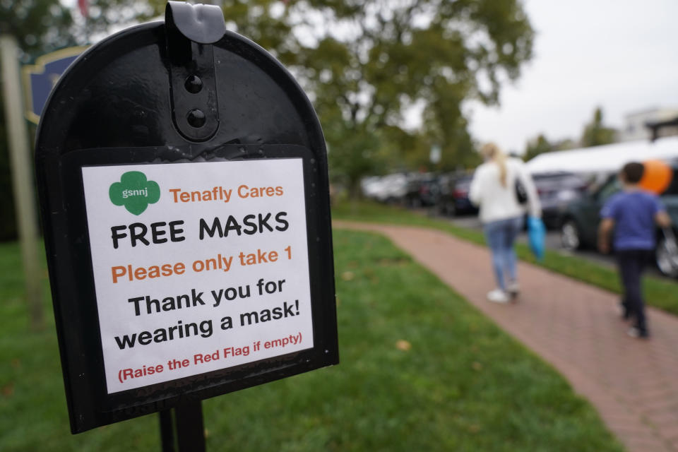 A mailbox containing free masks for pedestrians stands in the center of Tenafly, N.J., Thursday, Oct. 22, 2020. New Jersey's climbing number of COVID-19 cases are beginning to spread to northern counties around New York, Gov. Phil Murphy said Thursday. Essex, Union, Hudson and Bergen counties reported more than 100 new cases overnight, Murphy said, eclipsing recent hot spots in Ocean and Monmouth counties. (AP Photo/Seth Wenig)