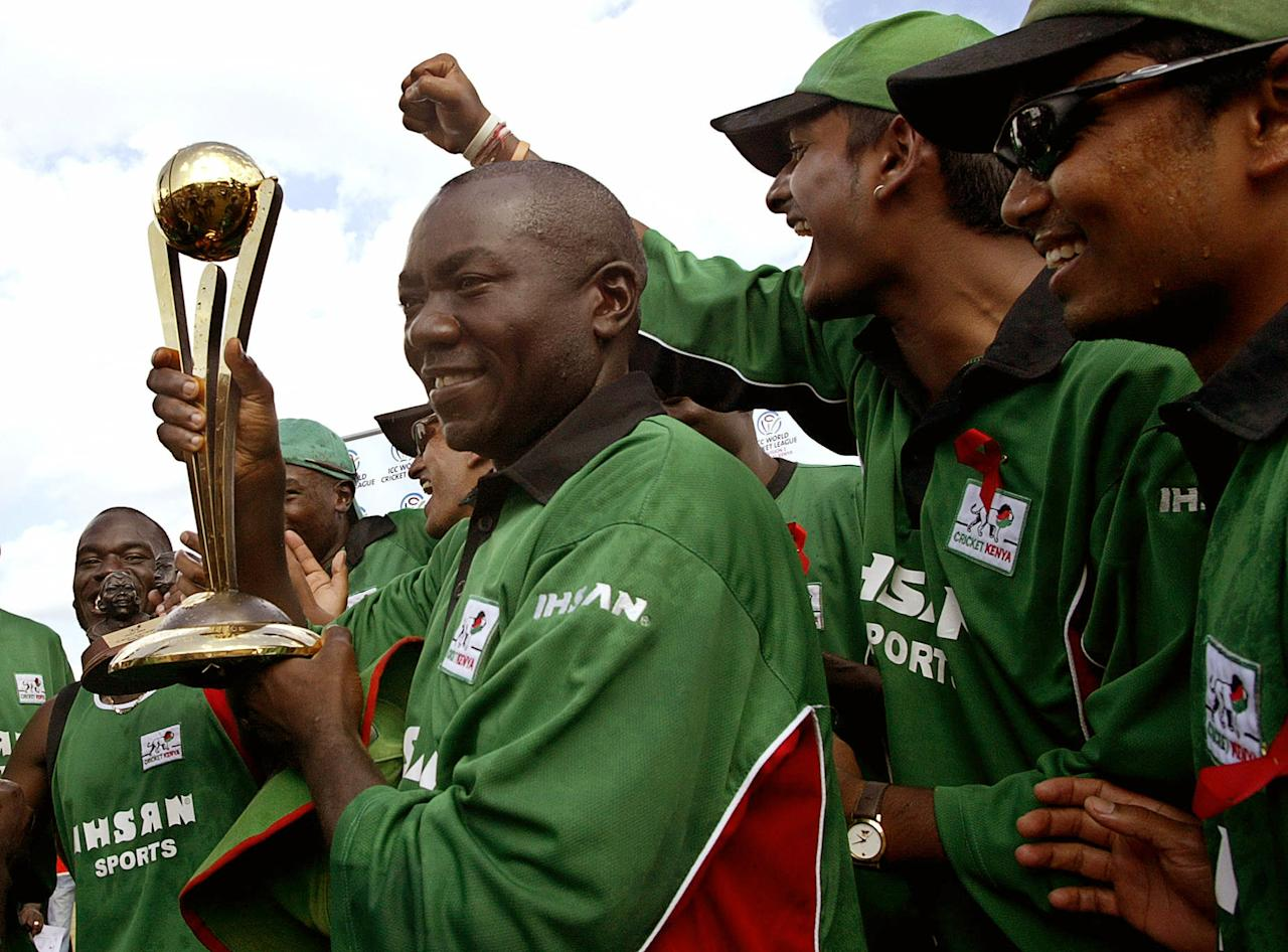 Kenya team captain Steve Tikolo celebrates with teammates 07 February 2007 after beating Scotland in the ICC World Cricket League Division 1 final at Nairobi's Gymkhana Sports Ground.  AFP PHOTO / TONY KARUMBA