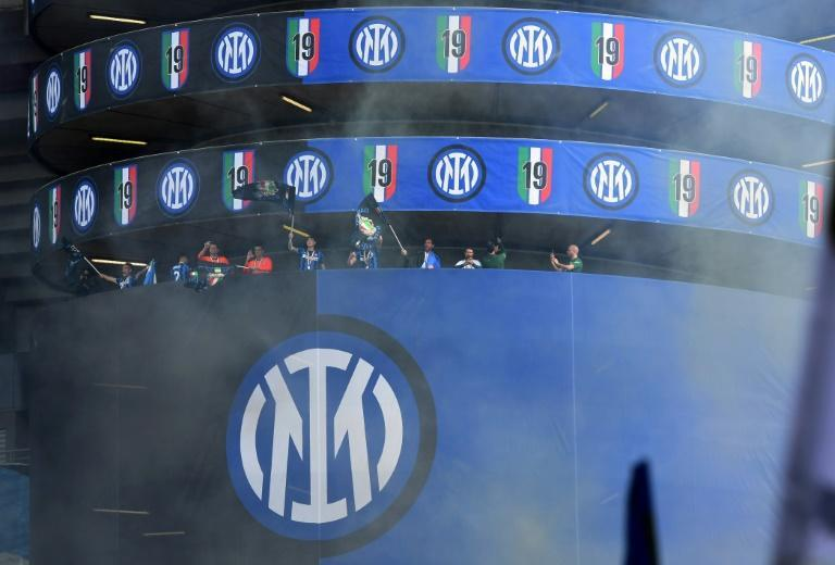 Inter Milan players celebrate the club's 19th Serie A title at the San Siro.
