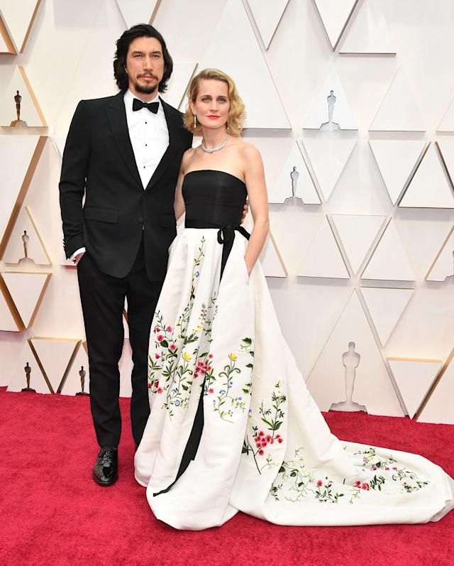 Adam Driver is wearing a Burberry tuxedo while his wife, Joanne Tucker, chose a vintage Oscar de la Renta gown. <em>[Photo: Getty]</em>