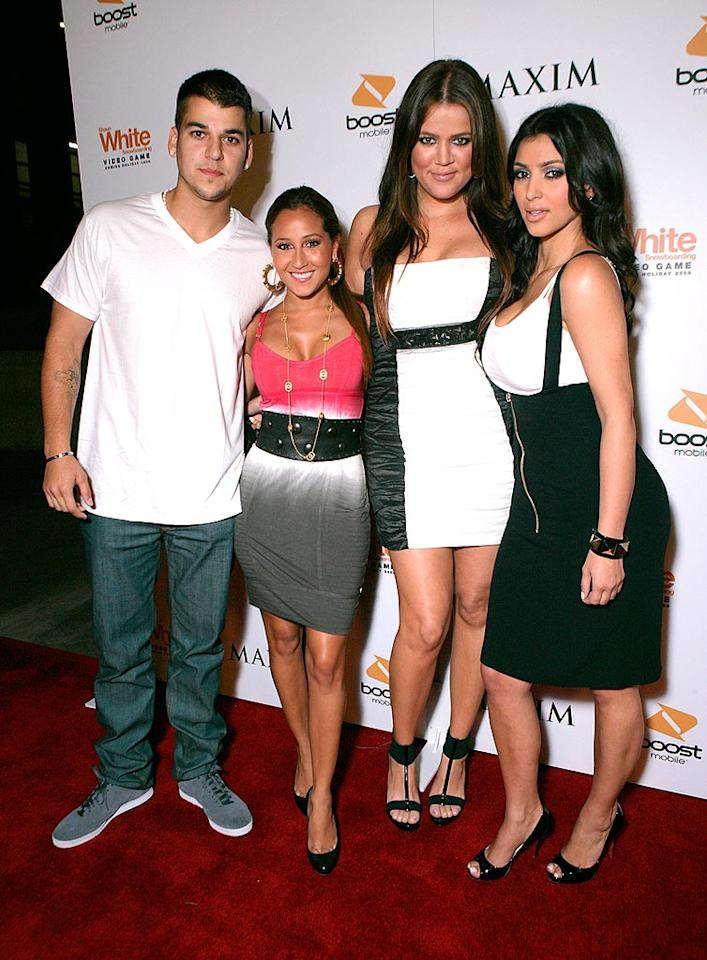 "Robert Kardashian, his girlfriend Adrienne Bailon, Khloe Kardashian, and Kim Kardashian pose for a pic on the red carpet. Todd Williamson/<a href=""http://www.wireimage.com"" target=""new"">WireImage.com</a> - July 31, 2008"