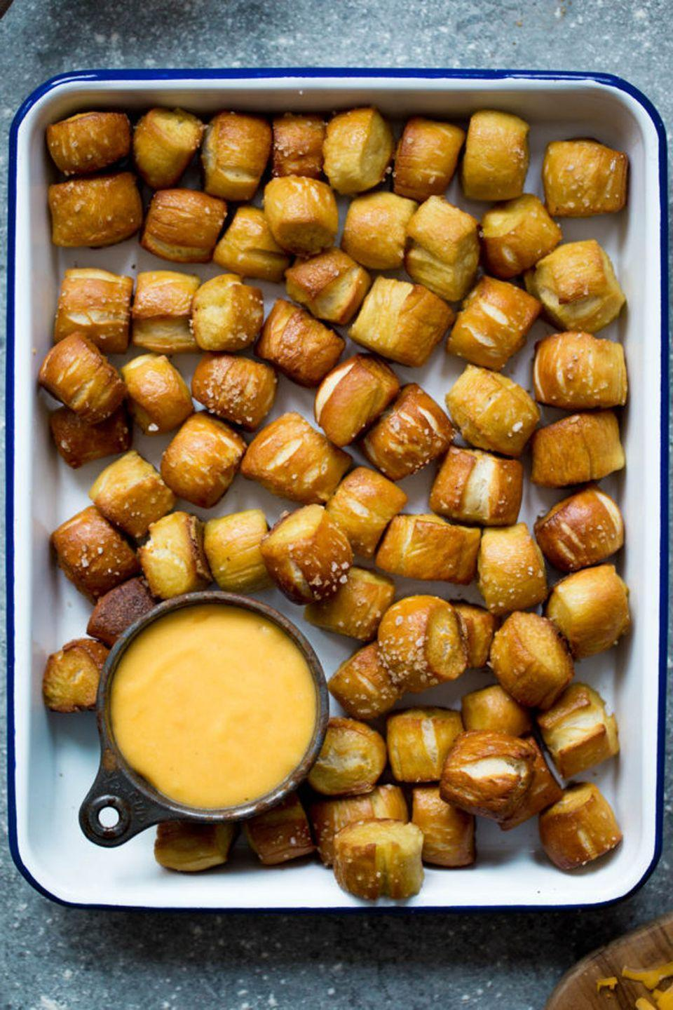 "<p>Dipping is the best part of this match-up featuring soft pretzel bites and a cheddar cheese sauce. </p><p><strong>Get the recipe at <a href=""http://www.twopeasandtheirpod.com/homemade-soft-pretzel-bites/"" rel=""nofollow noopener"" target=""_blank"" data-ylk=""slk:Two Peas and Their Pod"" class=""link rapid-noclick-resp"">Two Peas and Their Pod</a>.</strong> </p>"
