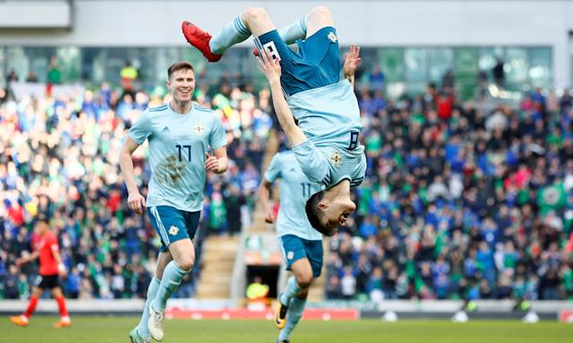 Northern Ireland's Paul Smyth celebrates scoring their winner against South Korea with a backwards flip.