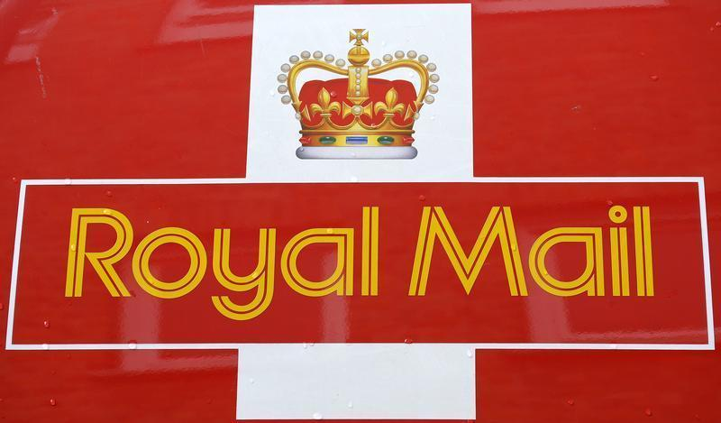 Rain drops fall on a Royal Mail van outside it's Bethnal Green sorting office in east London