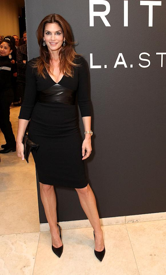 """Fellow supermodel Cindy Crawford turned heads this week when she arrived at the Getty Museum to celebrate the opening of the """"Herb Ritts: L.A. Style"""" exhibition. The 46-year-old mom of two looked phenomenal in a leather-accented LBD and pointy black pumps. A matching clutch, freshly highlighted locks, and a gold watch made for the perfect accessories. (4/2/2012)"""