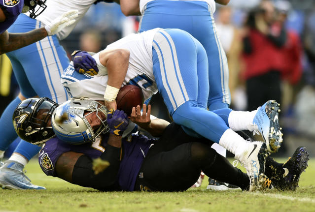 <p>Baltimore Ravens outside linebacker Terrell Suggs, bottom, sacks Detroit Lions quarterback Matthew Stafford in the second half of an NFL football game, Sunday, Dec. 3, 2017, in Baltimore. (AP Photo/Gail Burton) </p>
