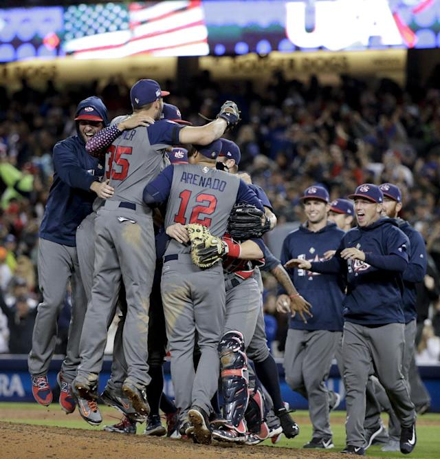 <p>U.S. players celebrate an 8-0 win over Puerto Rico in the final of the World Baseball Classic in Los Angeles, Wednesday, March 22, 2017. (AP Photo/Jae C. Hong) </p>