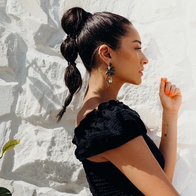 """<p>Hairstyles that <em>look</em> difficult to create but are actually crazy-easy are the best kind of styles. To DIY this look, tie your hair into a ponytail, then section off the ends of your hair with equally spaced <a href=""""https://www.amazon.com/Elastic-Teenitor-2000pcs-Rubber-Elastics/dp/B07FK8YBPC/"""" rel=""""nofollow noopener"""" target=""""_blank"""" data-ylk=""""slk:elastics"""" class=""""link rapid-noclick-resp"""">elastics</a> every few inches. Pouf out each section of hair by <strong>pulling gently to create a bubble effect</strong>. See? Not so tough.</p><p><a href=""""https://www.instagram.com/p/BmORwooneGc/"""" rel=""""nofollow noopener"""" target=""""_blank"""" data-ylk=""""slk:See the original post on Instagram"""" class=""""link rapid-noclick-resp"""">See the original post on Instagram</a></p>"""