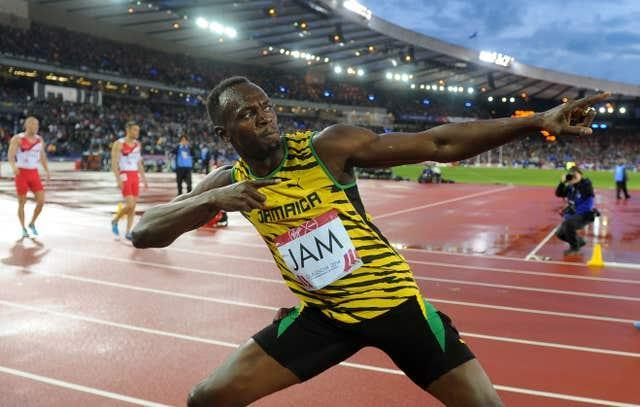 Usain Bolt celebrates winning the men's 4x100m relay at Hampden Park during the 2014 Commonwealth Games
