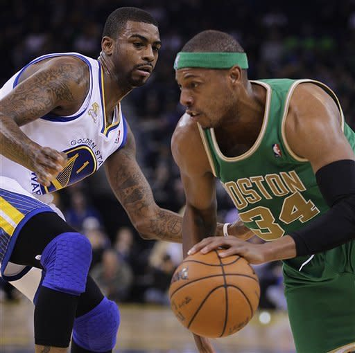 Boston Celtics' Paul Pierce, right, drives against Golden State Warriors' Dorell Wright (1) during the first half of an NBA basketball game Wednesday, March 14, 2012, in Oakland, Calif. (AP Photo/Ben Margot)