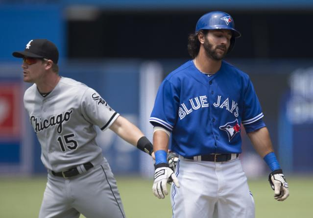 Toronto Blue Jays' Darin Mastroianni, right, is tagged out by Chicago White Sox's Gordon Beckham after making a base running error and getting caught in a rundown during the first inning of a baseball game in Toronto on Sunday, June 29, 2014. (AP Photo/The Canadian Press, Darren Calabrese)