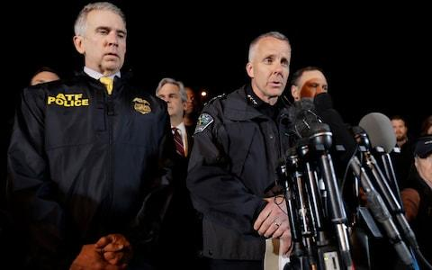 Austin Police Chief Brian Manley, right, stands with other members of law enforcement as he briefs the media - Credit: Eric Gay /AP