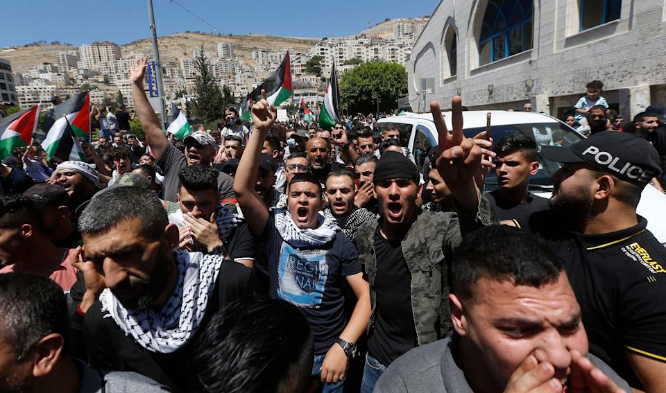 Palestinian protesters shout slogans against Israel during a rally to support Gaza in the West Bank City of Nablus (EPA)