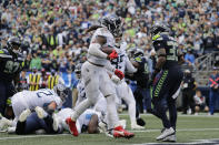 Tennessee Titans running back Derrick Henry, 22, scores a touchdown against the Seattle Seahawks during the second half of an NFL football game, Sunday, Sept. 19, 2021, in Seattle. The extra point was good and the score tied the game at 30-30. (AP Photo/John Froschauer)
