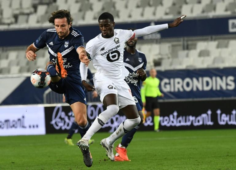 US international Timothy Weah (R) scored Lille's second goal in Bordeaux