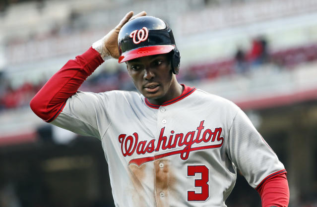 FILE- In this March 30, 2018, file photo, Washington Nationals' Michael A. Taylor runs back to the dugout after scoring in the ninth inning of an opening day baseball game against the Cincinnati Reds in Cincinnati. Taylor favored his left leg as he limped through the clubhouse Friday, March 15, 2019, before heading to have an MRI exam on his sore knee and hip. He said his knee and hip stiffened up after he made a diving catch against Minnesota on Thursday. (AP Photo/John Minchillo, File)