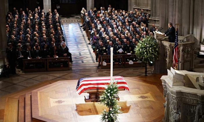 Former president George W Bush delivers his eulogy during a funeral service at the National Cathedral in Washington DC on Wednesday.