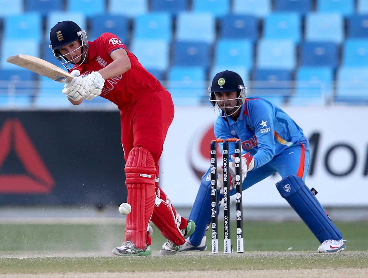 DUBAI, UNITED ARAB EMIRATES - FEBRUARY 22:  Joe Clarke of England bats as wicket-keeper Ankush Bains of India looks on during the ICC U19 Cricket World Cup 2014 Quarter Final match between England and India at the Dubai Sports City Cricket Stadium on February 22, 2014 in Dubai, United Arab Emirates.  (Photo by Francois Nel - IDI/IDI via Getty Images)
