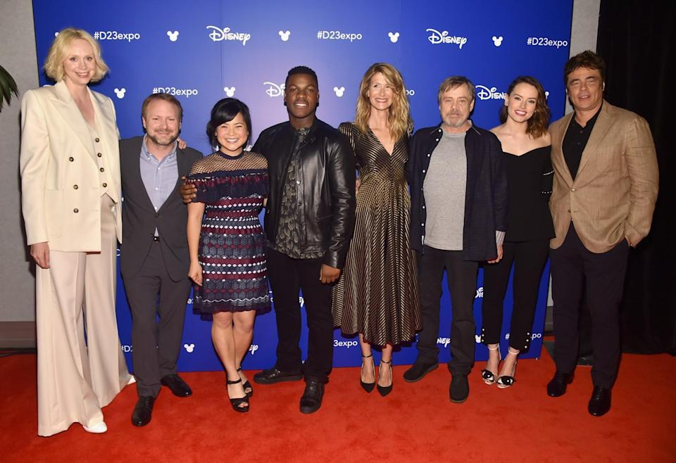 <p>Gwendoline Christie (Captain Phasma), writer-director Rian Johnson, Kelly Marie Tran (Rose), John Boyega (Finn), Laura Dern (Vice Admiral Amilyn Holdo), Mark Hamill (Luke Skywalker), Daisy Ridley (Rey), and Benicio Del Toro (D.J.) are all smiles after unspooling behind-the-scenes footage of the next <em>Star Wars</em>. (Photo: Getty Images for Disney) </p>