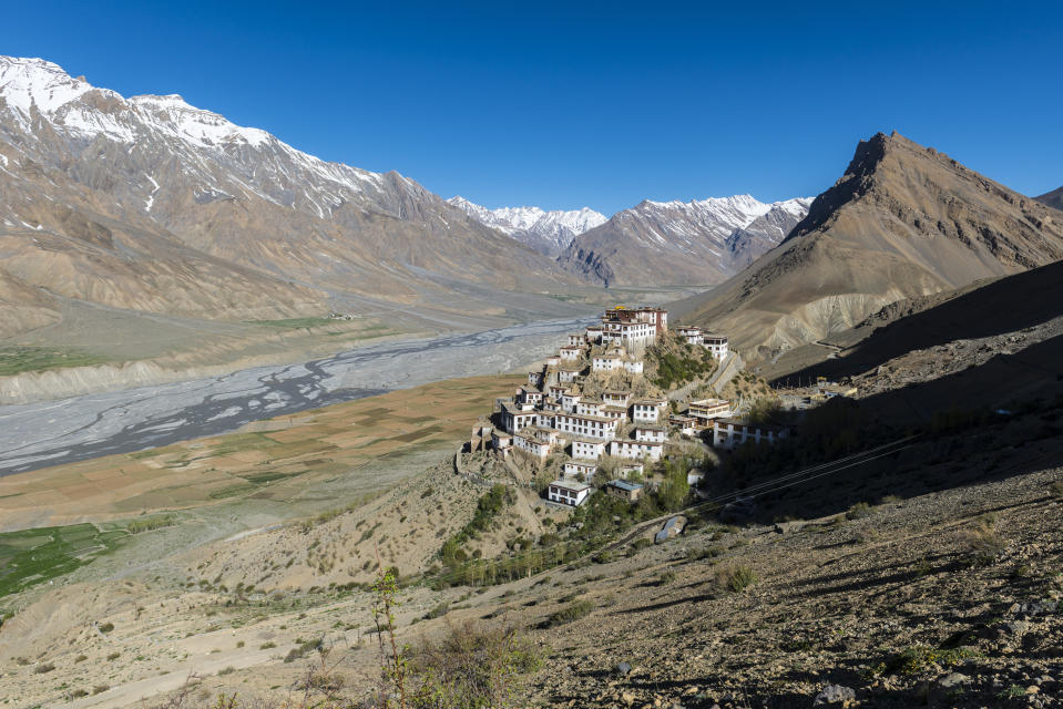 HIMACHAL PRADESH, INDIA - 2013/06/05: Aerial view on Ki Gompa, a Tibetan Buddhist monastery located on top of a hill at an altitude of 4,166 metres, the Spiti Valley and snow covered mountains in the background.. (Photo by Frank Bienewald/LightRocket via Getty Images)