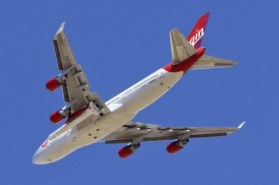 Virgin Orbit Boeing 747-400 rocket launch platform, named Cosmic Girl, takes off from Mojave Air and Space Port, Mojave (MHV) on its second orbital launch demonstration in the Mojave Desert, north of Los Angeles. (AP Photo/Matt Hartman)