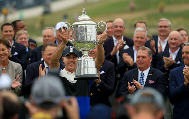 FARMINGDALE, NEW YORK - MAY 19: Brooks Koepka of the United States poses with the Wanamaker Trophy during the Trophy Presentation Ceremony after winning the final round of the 2019 PGA Championship at the Bethpage Black course on May 19, 2019 in Farmingdale, New York. (Photo by Mike Ehrmann/Getty Images)