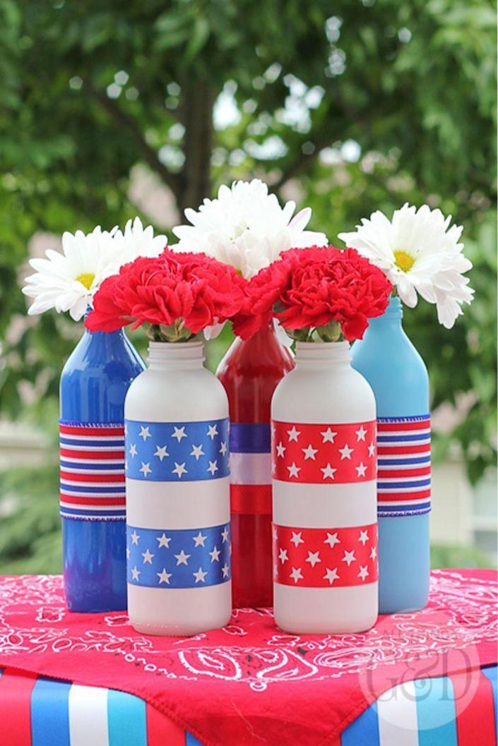 """<p>Put old bottles and jars to use by creating a stunning floral centerpiece.</p><p><em><strong>Get the tutorial from <a href=""""http://www.allthingsgd.com/2014/06/patriotic-painted-glass-bottles/"""" rel=""""nofollow noopener"""" target=""""_blank"""" data-ylk=""""slk:All Things G&D"""" class=""""link rapid-noclick-resp"""">All Things G&D</a>.</strong></em></p>"""