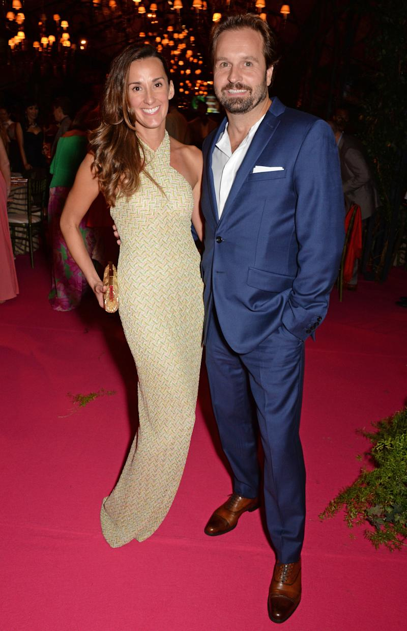 WINDSOR, ENGLAND - SEPTEMBER 04: PREMIUM PRICING APPLIES. Alfie Boe (R) and wife Sarah Boe attend the Woodside End of Summer party to benefit the Elton John AIDS Foundation sponsored by Chopard and Grey Goose at Woodside on September 4, 2014 in Windsor, England. A percentage of revenue from the sale of this image will be donated to the Elton John AIDS Foundation. EJAF is one of the world's largest HIV grant-makers ejaf.org/London (Photo by Dave Benett/Elton John AIDS Foundation/WireImage)