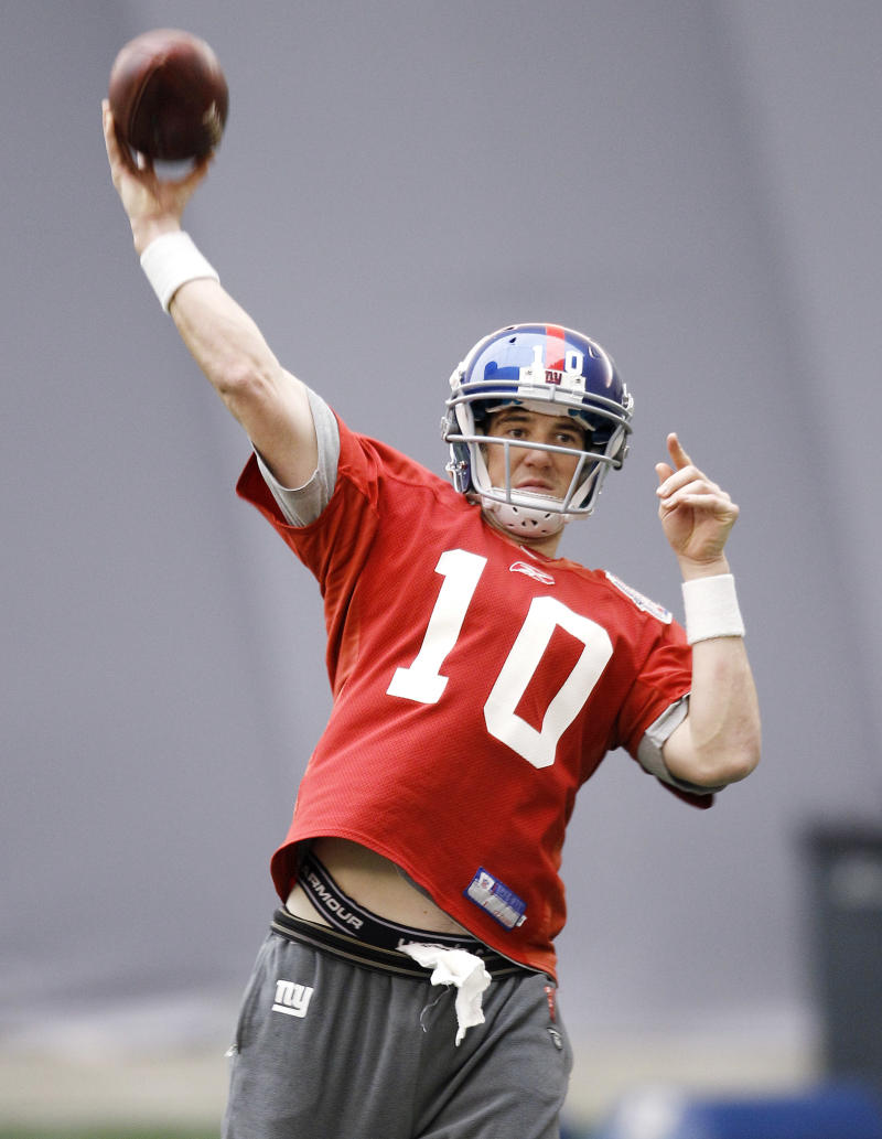 New York Giants' Eli Manning during practice, Friday, Feb. 3, 2012, in Indianapolis. The Giants will face the New England Patriots in the NFL football Super Bowl XLVI  on Feb. 5.(AP Photo/Eric Gay)