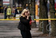<p>A pedestrian walks along a police crime scene tape near where a van struck multiple people at a major intersection in Toronto's northern suburbs in Toronto, Ontario, Canada, April 23, 2018. REUTERS/Carlo Allegri </p>