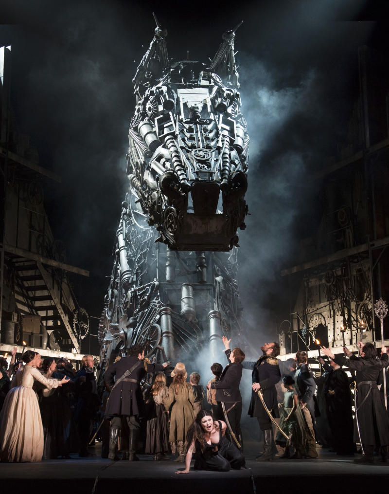 In this image released by the Royal Opera house in London, Monday, June 25, 2012 show the cast of the opera Les Troyens, taken on Friday, June 22, 2012. The version by director David McVicar which premiered Monday, June 25 marks the first time the company has performed the full opera in 40 years. It's an official event of the London 2012 Festival being held in conjunction with the Olympics _ and set designer Es Devlin is also designing the closing ceremony for the Games. (AP Photo/Bill Cooper, Royal Opera House)