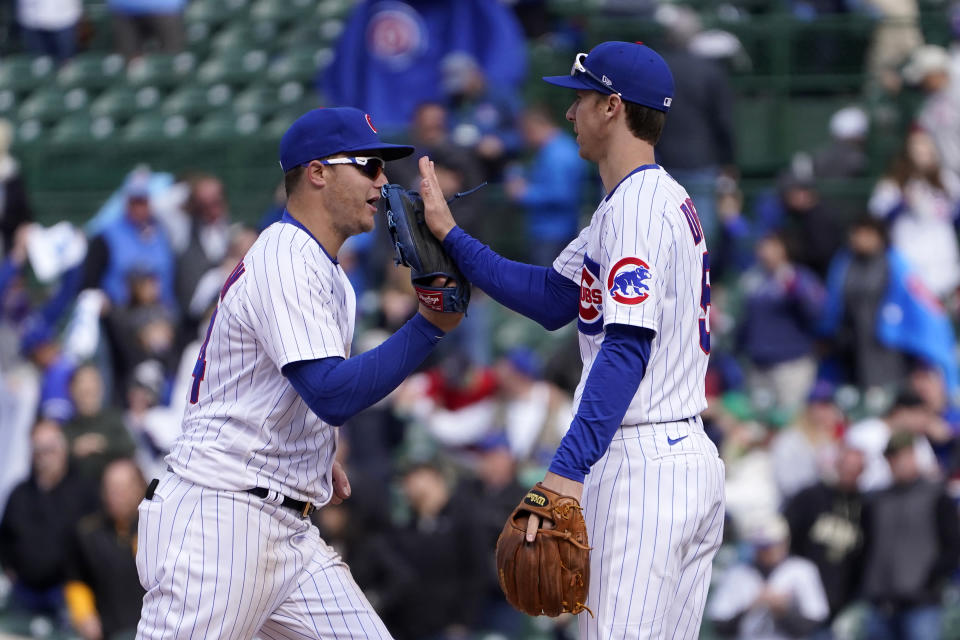 Chicago Cubs' Joc Pederson, left, and Matt Duffy celebrate their win over the Pittsburgh Pirates after a baseball game Friday, May 7, 2021, in Chicago. (AP Photo/Charles Rex Arbogast)