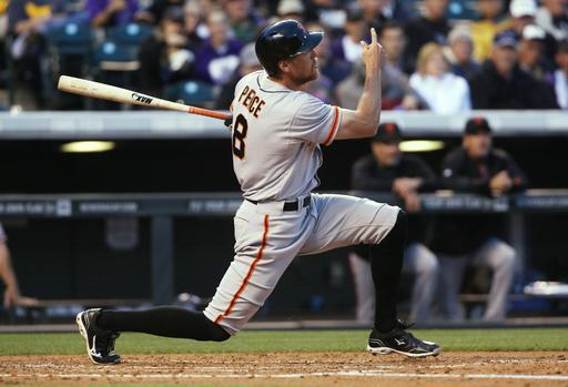 San Francisco Giants' Hunter Pence follows the flight of his solo home run against the Colorado Rockies to lead off the fourth inning of a baseball game in Denver on Wednesday, May 21, 2014. (AP Photo/David Zalubowski)