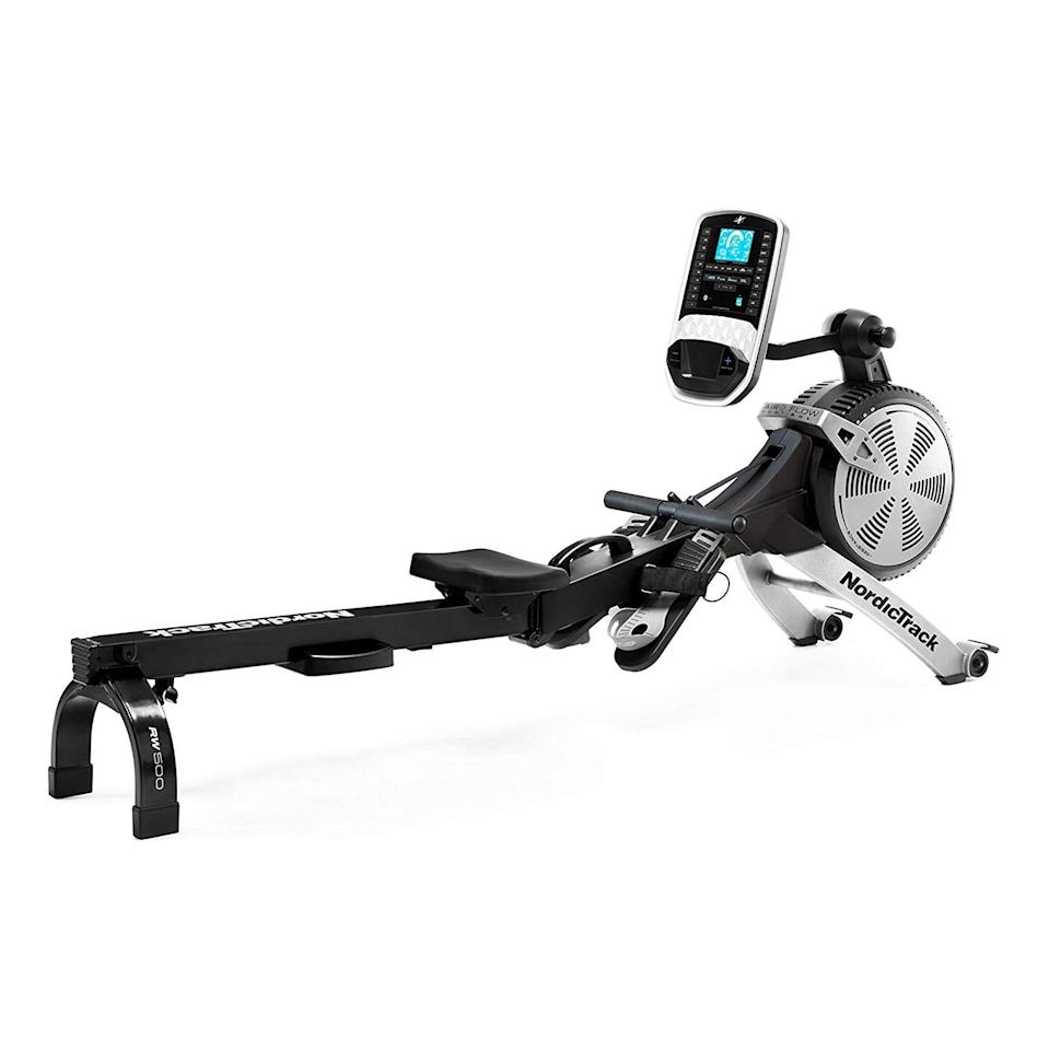 """<p><strong>NordicTrack</strong></p><p>amazon.com</p><p><strong>$799.99</strong></p><p><a href=""""https://www.amazon.com/dp/B085JVR7XQ?tag=syn-yahoo-20&ascsubtag=%5Bartid%7C2141.g.27547247%5Bsrc%7Cyahoo-us"""" rel=""""nofollow noopener"""" target=""""_blank"""" data-ylk=""""slk:Shop Now"""" class=""""link rapid-noclick-resp"""">Shop Now</a></p><p>Another top pick from NordicTrack, the RW900 offers ultra-smooth motion—on top of the personalized guidance you get from an included one-year iFit membership. With <strong>a silent flywheel, Bluetooth compatibility, and the ability to fold in half</strong> for easy storage, this rower is more than worth the investment. On the console, you'll also find buttons to easily adjust the resistance.</p>"""