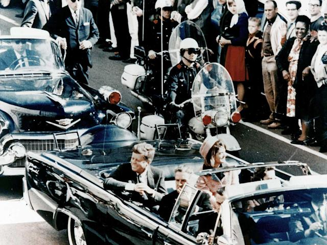 <p>President John F Kennedy in the presidential limousine before his assassination. His wife Jacqueline is next to him and Texas Governor John Connally and his wife Nellie sit in front. (Photo: Universal History Archive/UIG via Getty Images) </p>