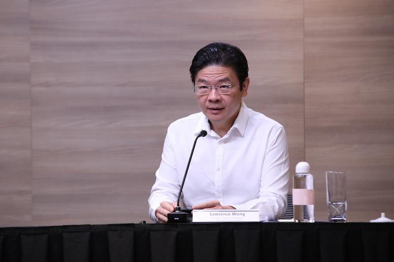 National Development Minister and multi-ministry taskforce on COVID-19 co-chair Lawrence Wong addresses reporters at a virtual press conference oin May 2020. PHOTO: MCI
