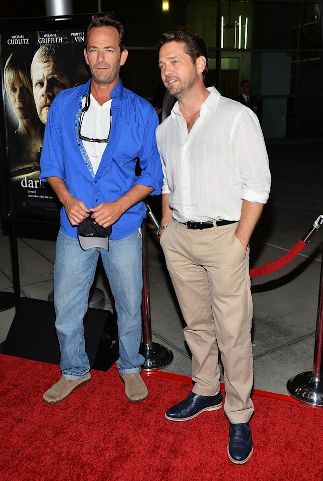 "HOLLYWOOD, CA - AUGUST 14:  Actors Luke Perry (L) and Jason Priestley arrive at the premiere of ""Dark Tourist"" at ArcLight Hollywood on August 14, 2013 in Hollywood, California.  (Photo by Amanda Edwards/Getty Images)"