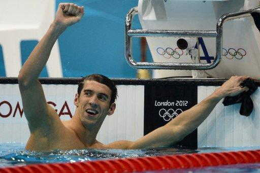 US swimmer Michael Phelps celebrates after winning gold in the men's 100m butterfly final at the London Olympics on August 3. Phelps closed his Olympic individual career in breathtaking style as America ruled the pool and records tumbled on the cycle track