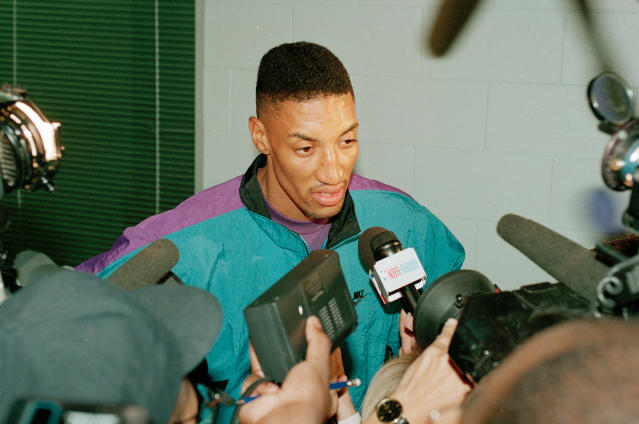 """<a class=""""link rapid-noclick-resp"""" href=""""/nba/teams/chicago/"""" data-ylk=""""slk:Chicago Bulls"""">Chicago Bulls</a>' Scottie Pippen talks with reporters after basketball practice at the Berto Center in Deerfield, Illinois, on May 24, 1994. Questions are being asked after Pippen sat on the bench as the Bulls beat the <a class=""""link rapid-noclick-resp"""" href=""""/nba/teams/new-york/"""" data-ylk=""""slk:Knicks"""">Knicks</a> 104-102, on Toni Kukoc's last-second shot. (AP/Todd Rosenberg)"""
