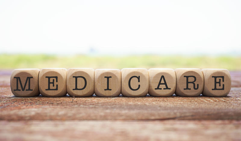 The word Medicare spelled out in round beads
