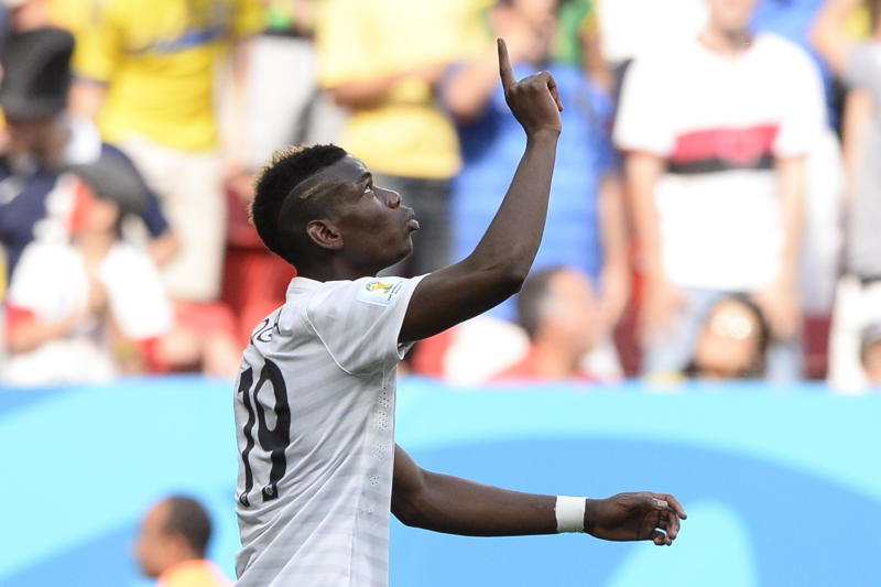 France's midfielder Paul Pogba celebrates after scoring a goal during the round of 16 football match between France and Nigeria at the Mane Garrincha National Stadium in Brasilia during the 2014 FIFA World Cup on June 30, 2014