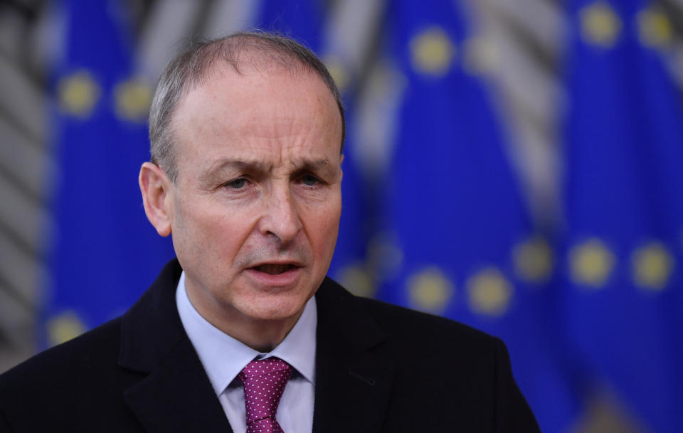 Ireland's Prime Minister Micheal Martin speaks as he arrives for an EU summit at the European Council building in Brussels, Thursday, Dec. 10, 2020. European Union leaders meet for a year-end summit that will address anything from climate, sanctions against Turkey to budget and virus recovery plans. Brexit will be discussed on the sidelines. (John Thys, Pool via AP)
